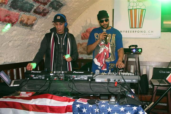 Two djs playing music