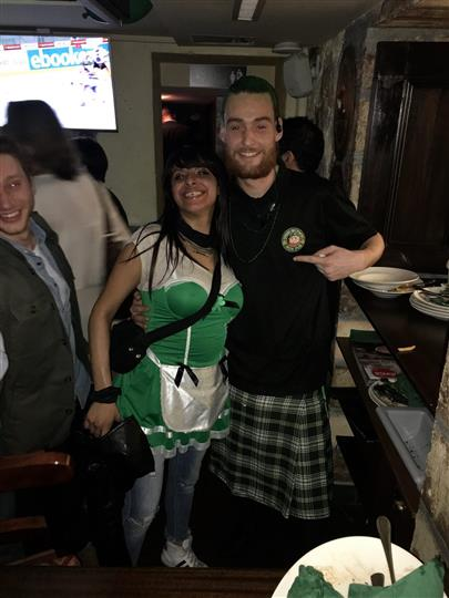 Two smiling employees of the pub posing for a photo