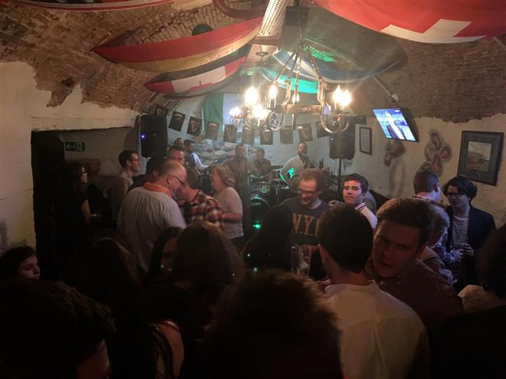 Interior shot of the pub full of people