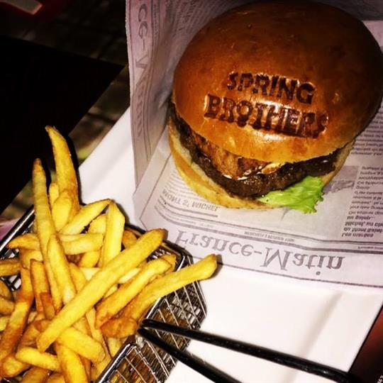 A burger served with french fries