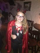 A young lady in a Halloween suit posing for a photo