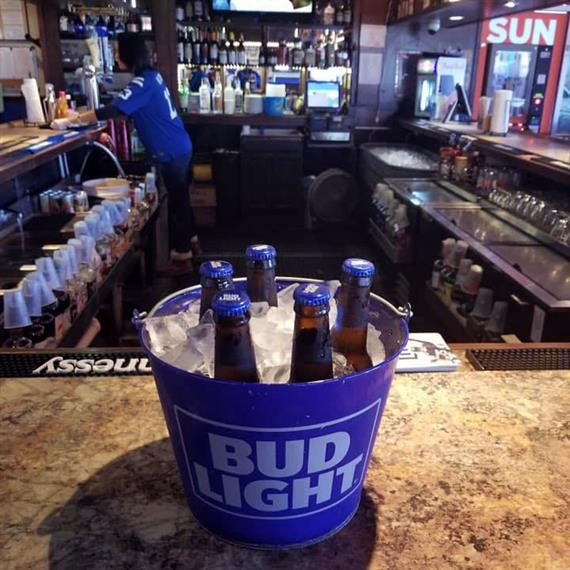 bucket filled with ice and bottles of beer inside