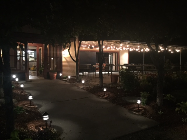 walkway to storefront at nighttime