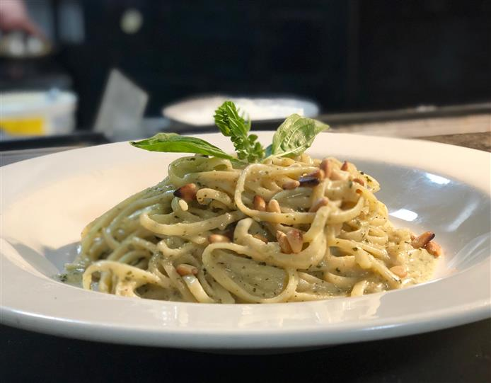 linguine with pesto and leafy garnish