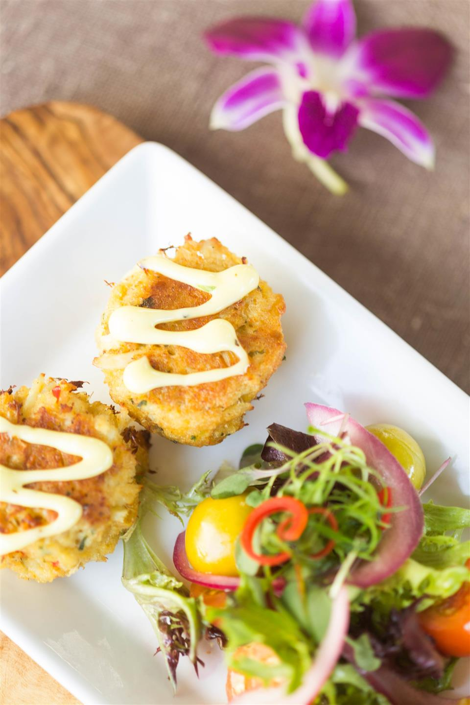 crab cakes and a salad