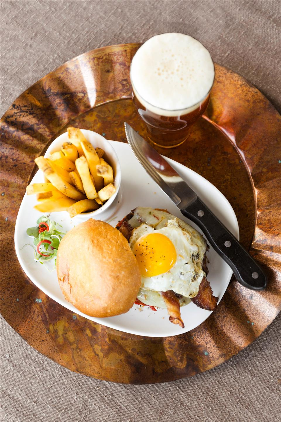 eggs, bacon, roll, french fries and glass of beer
