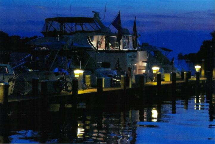 view of dock at night
