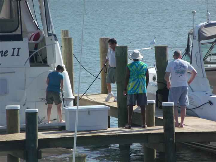up close view of people standing on boat dock
