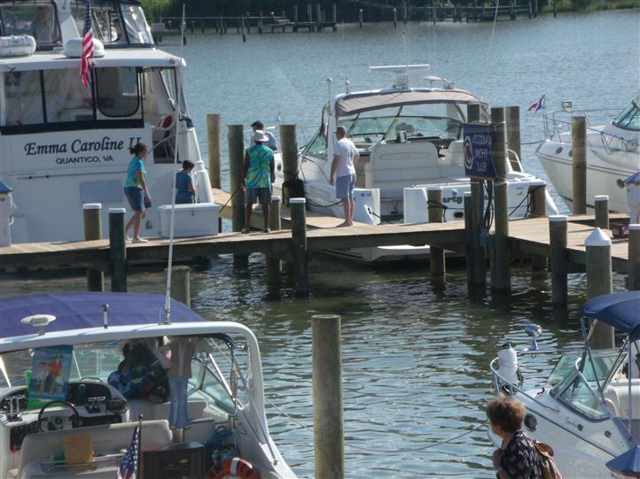 people standing on boat dock