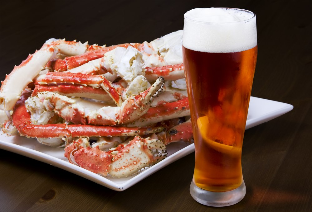 crab legs with a glass of beer