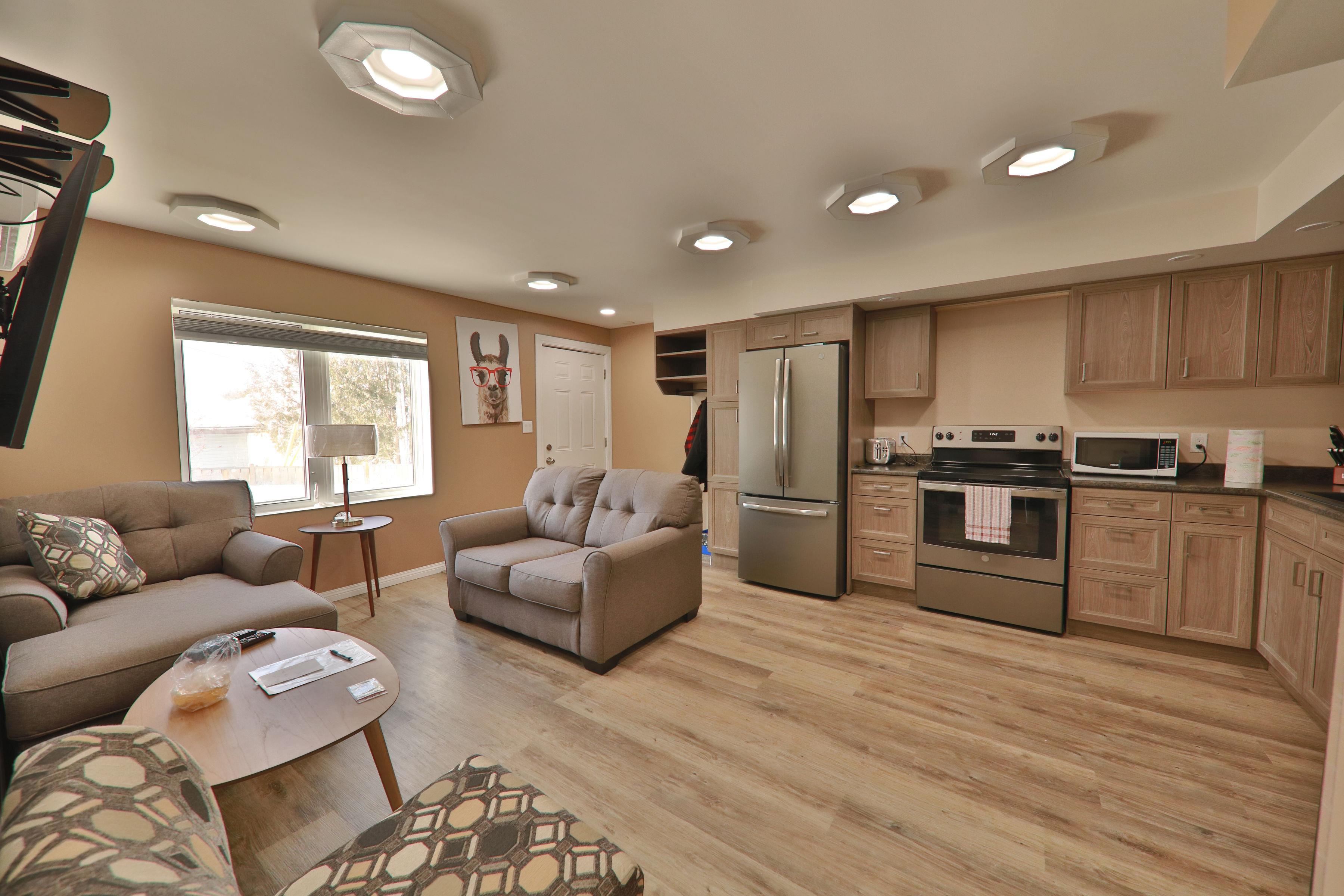 Interior of apartment with view of kitchen and living area