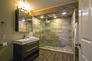 Bathroom with sink, mirror, shower