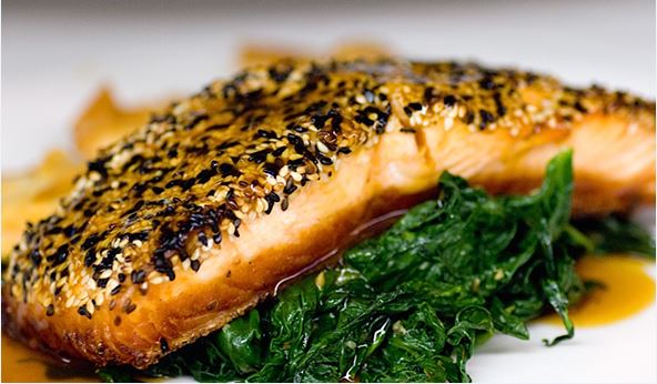 Salmon served on top of spinach