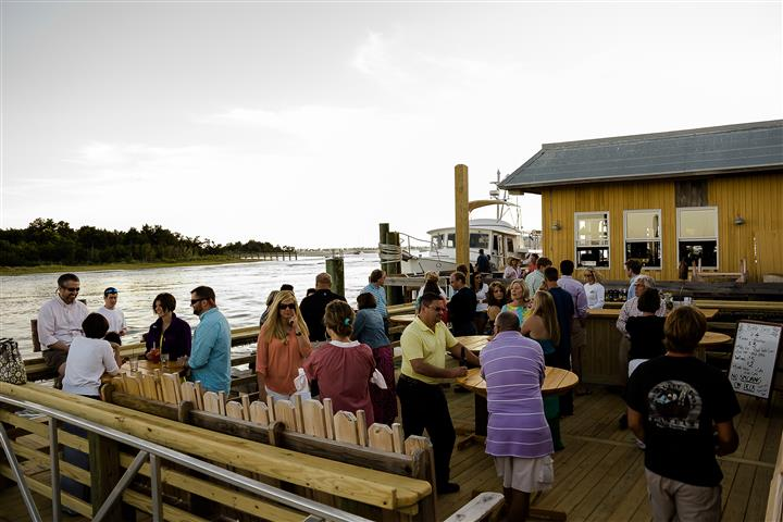 People socializing at a dock