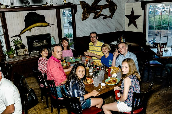 Family smiling for picture at dinner table
