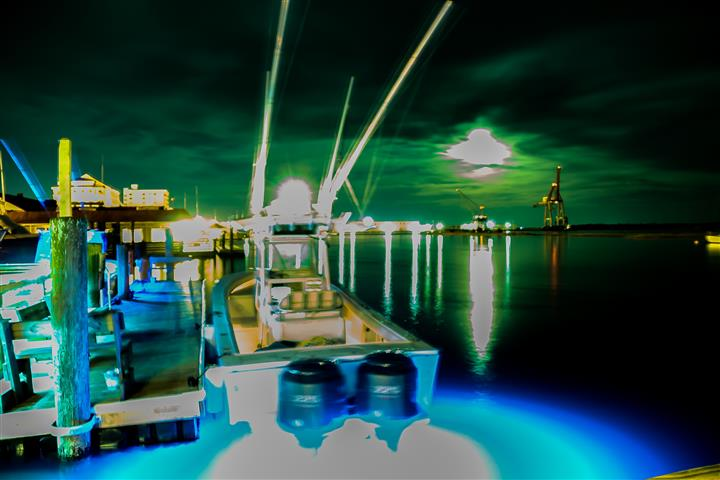 Boat on dock during the night