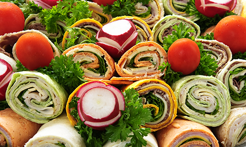 Assorted vegetable wraps in pile
