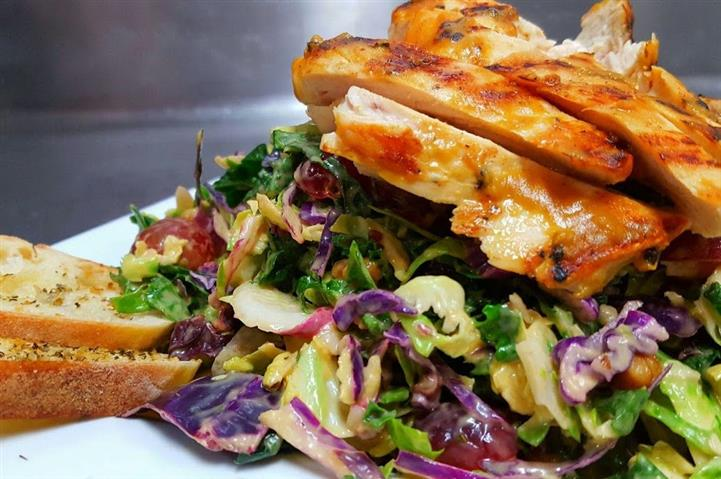 Grilled chicken over salad with side of toast points
