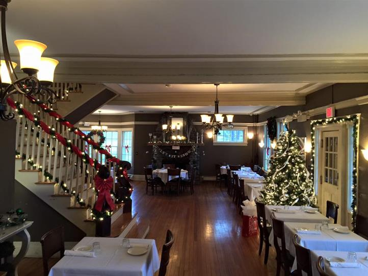 inside of restaurant decorated for christmas