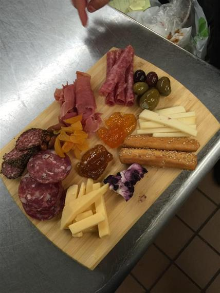 various meat and cheese on wooden board
