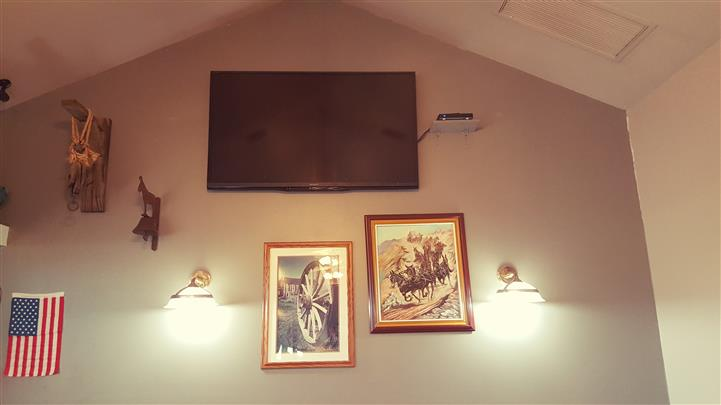 Pictures and TV inside restaurant