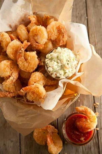fried shrimp basket with side of coleslaw and cocktail sauce