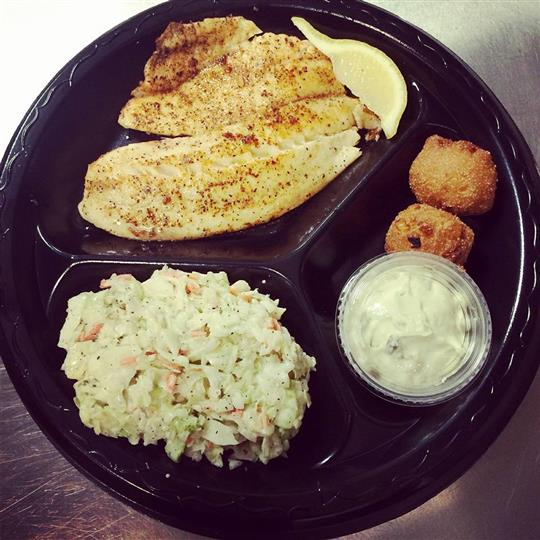 fried fish, coleslaw, and a side of tartar sauce on a segmented plate