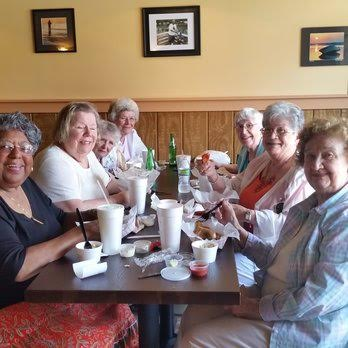 group of senior citizens dining together