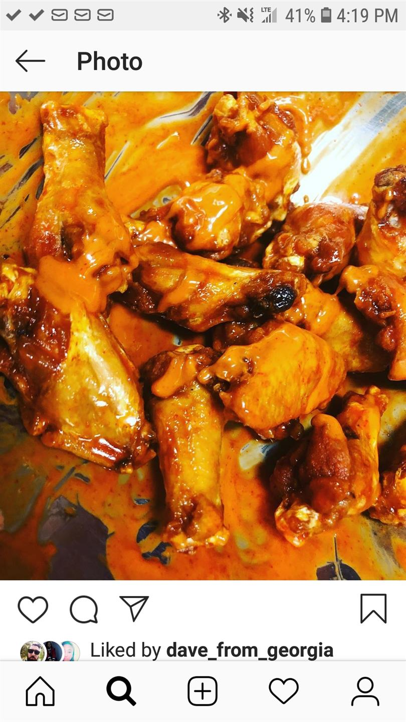 11 buffalo wings covered in buffalo sauce in a mixing bowl.