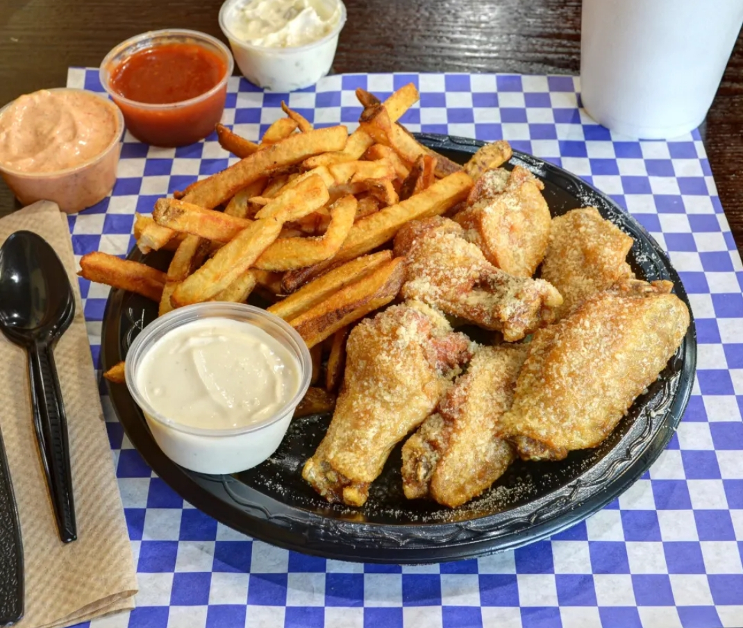 wings with a side of fries and dipping sauce