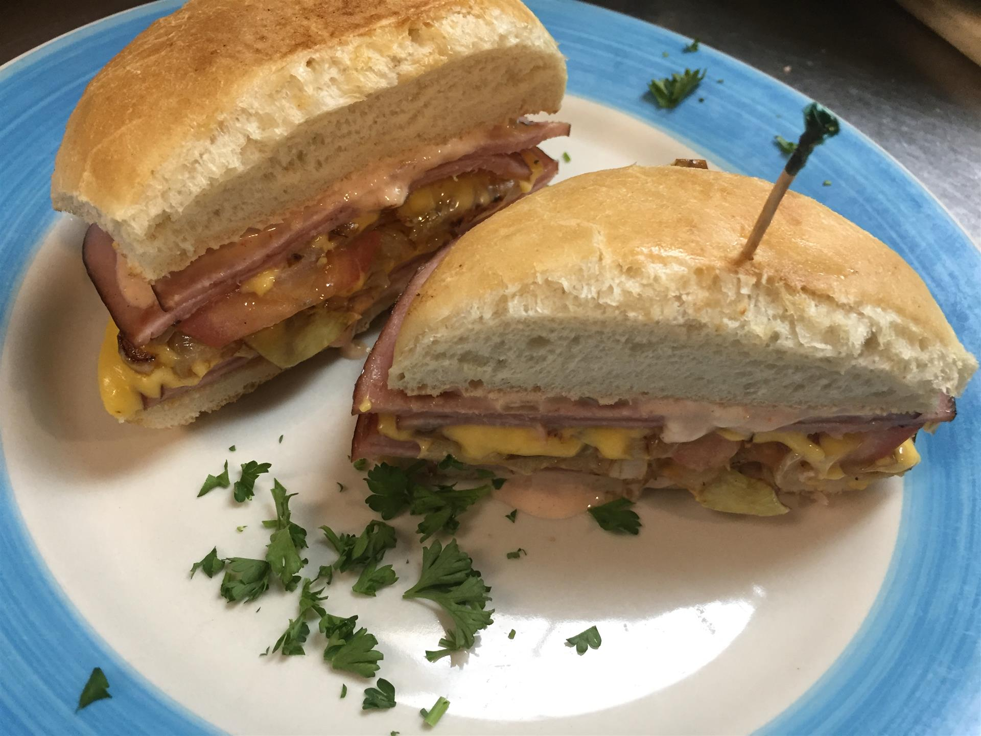 breakfast sandwhich with ham and eggs