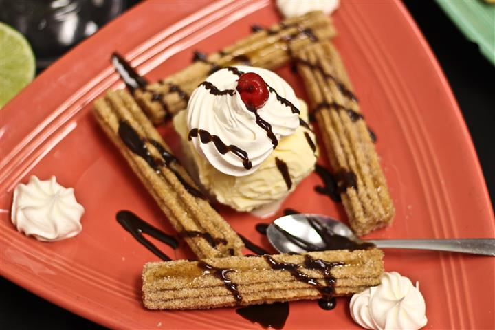 Churros with ice cream and chocolate drizzle
