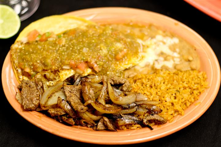 Steak and onions with rice and beans