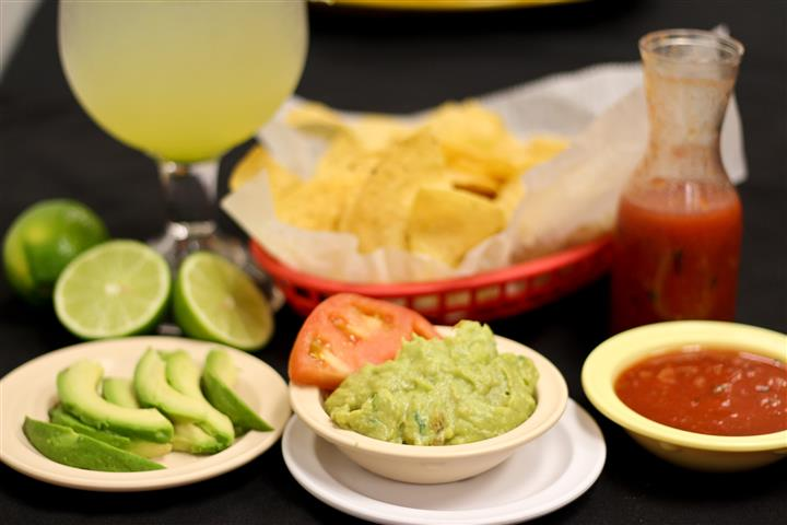 Chips and guacamole with tomato