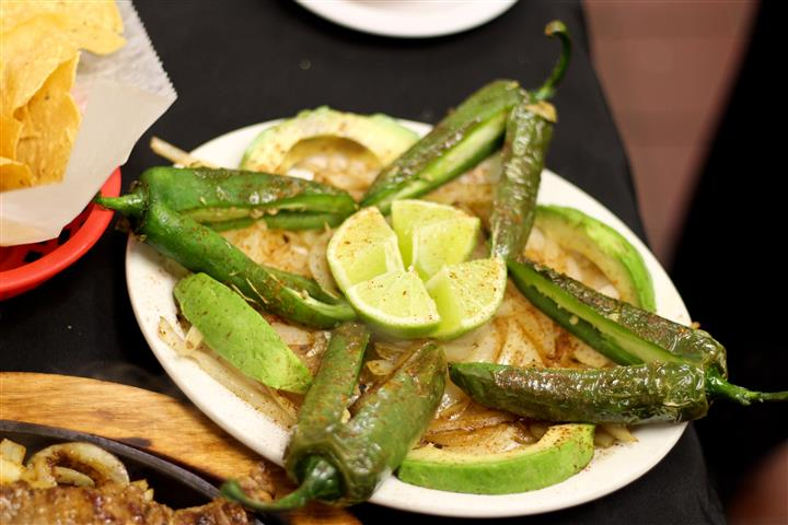 Sauteed peppers and onions with a lime on top