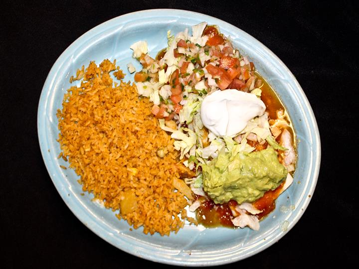 Enchiladas with sour cream and guacamole with side of rice