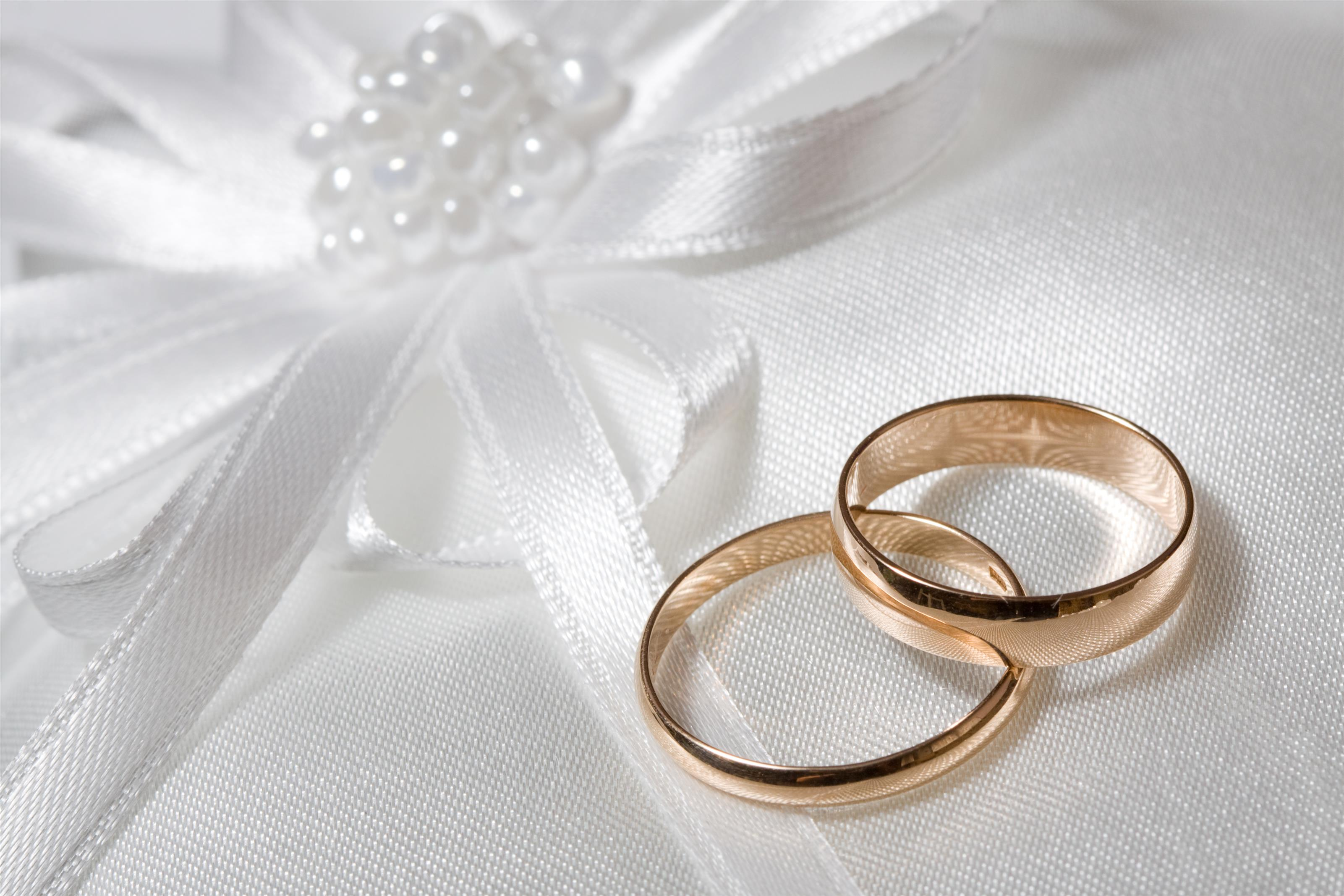 Gold wedding rings on elegant cloth