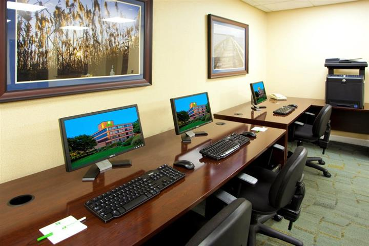 Tables in conference room set up with keyboards and monitors