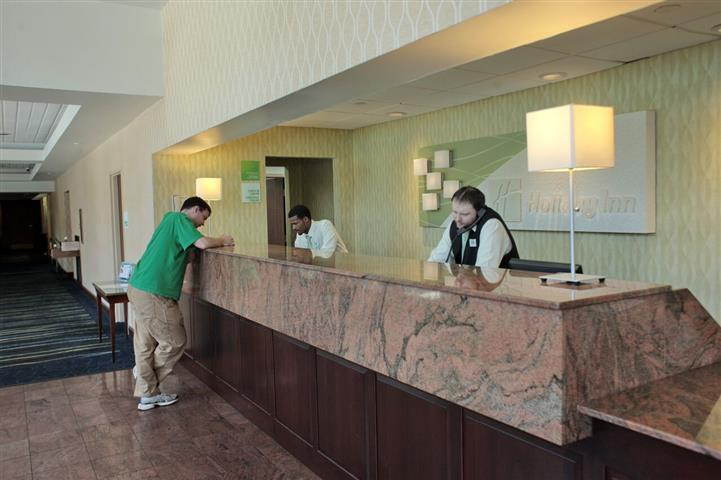Patron and employees at front desk