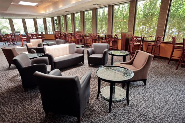 Lounge area with chairs, couches, dining tables and chairs