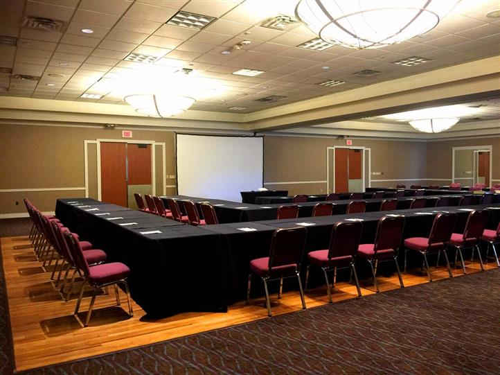 Conference room showing long tables and chirs