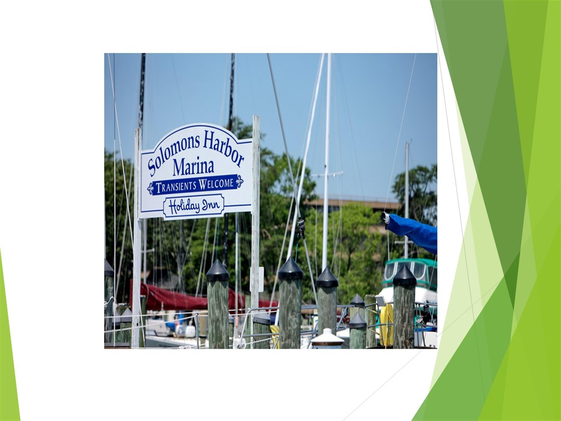 White sign on dock of harbor reading Solomon's Harbor Marina. Transients welcome. Holiday Inn.