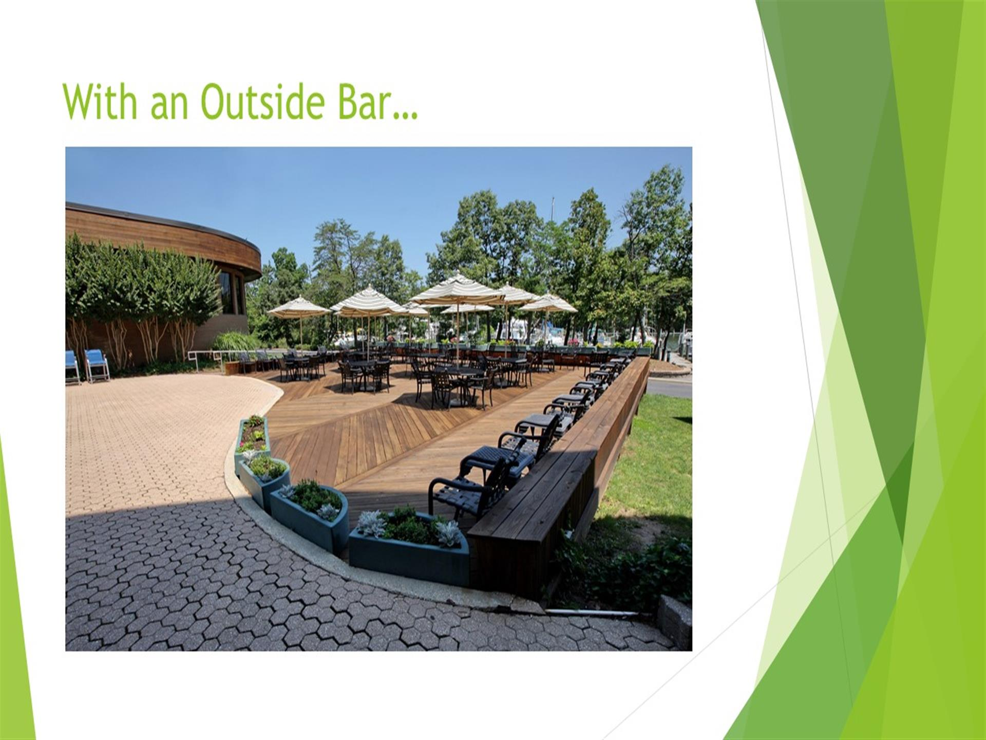 With an outside bar...outdoor deck with tables, umbrellas and chairs