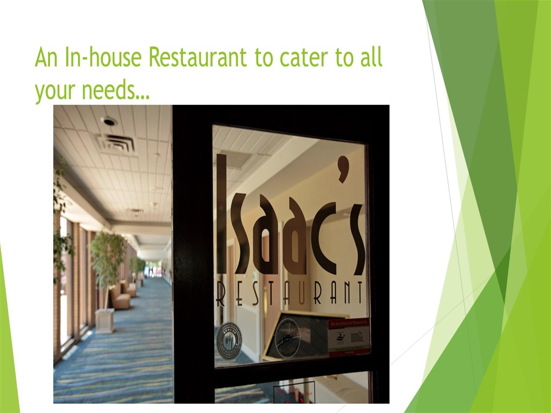 An in-house restaurant to cater to all your needs - door of Isaac's restaurant entrance to corridor with blue carpet