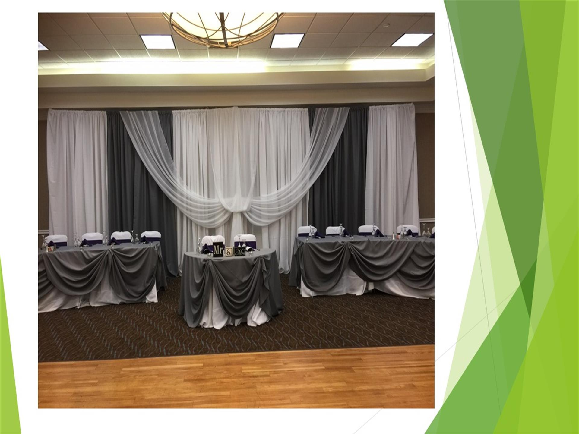 Wedding reception hall with tables and chairs dressed in gray and white