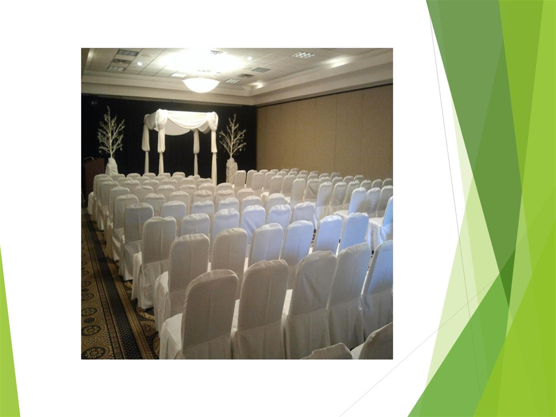 Wrapped white chairs at wedding ceremony
