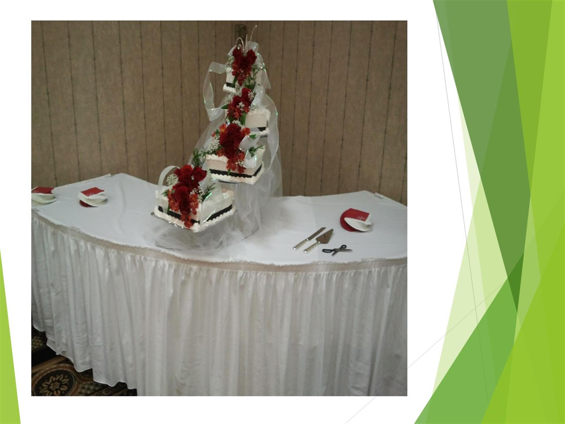 White cakes on tiered stand on white table