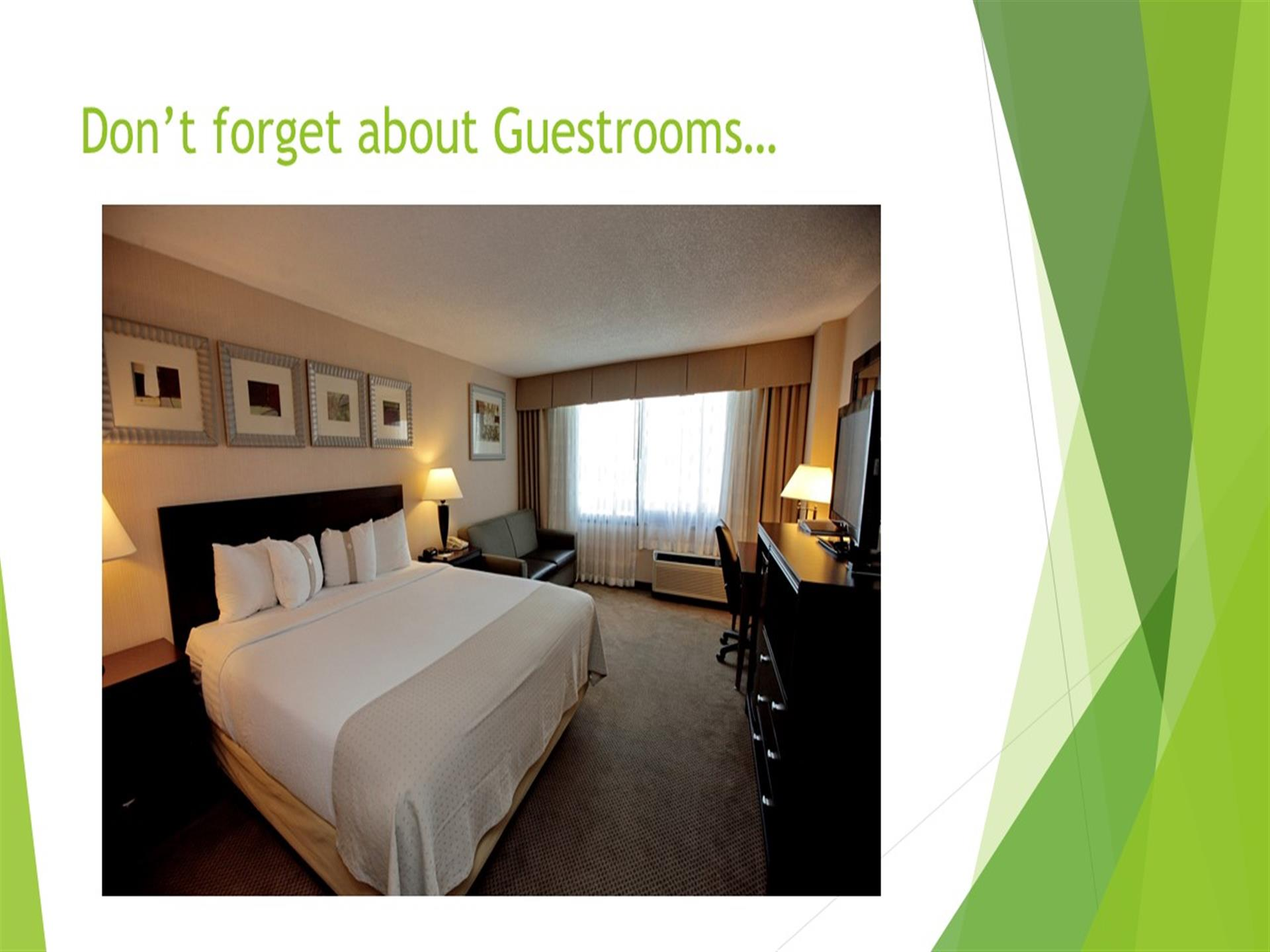 Don't forget about the guestrooms - hotel room with king size bed, couch, gray carpet, dresser, tv, desk