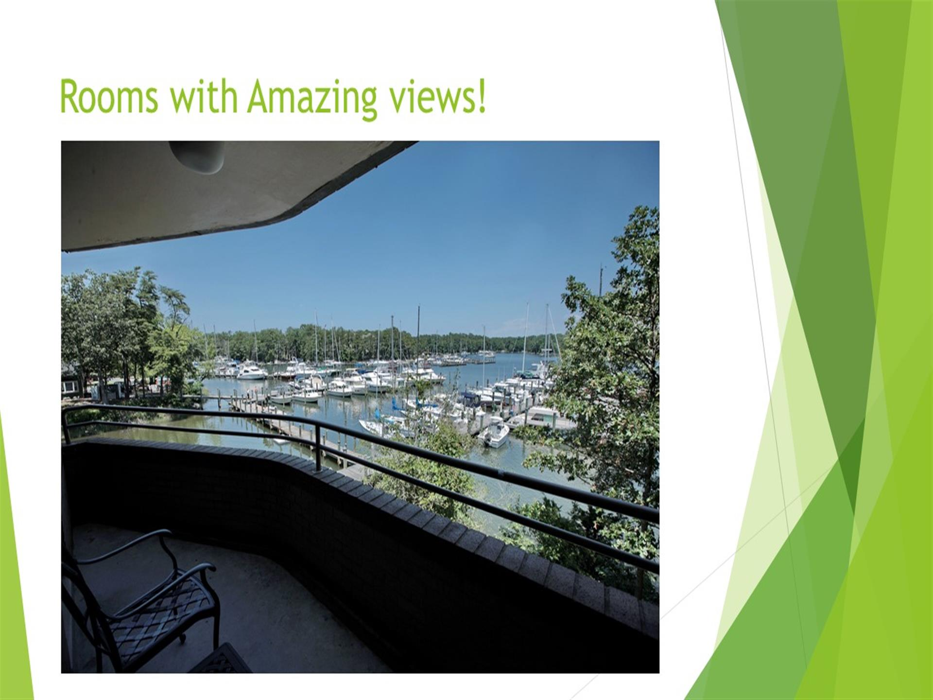 Rooms with amazing views - balcony overlooking harbor with docked boats