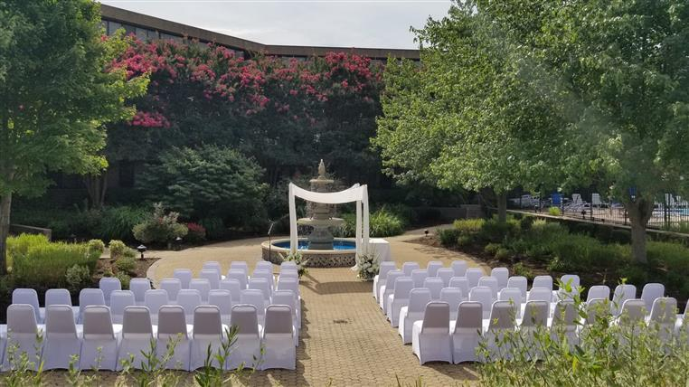 Chairs set up in court yard for outdoor wedding